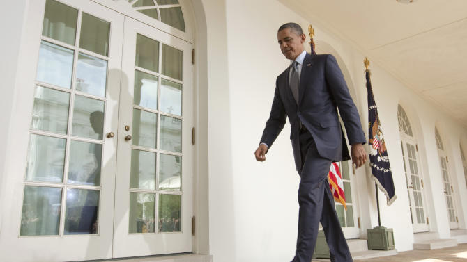 President Barack Obama walks to the Oval Office after making a statement in the Rose Garden of the White House in Washington, Monday, Sept. 19, 2011.  (AP Photo/Evan Vucci)