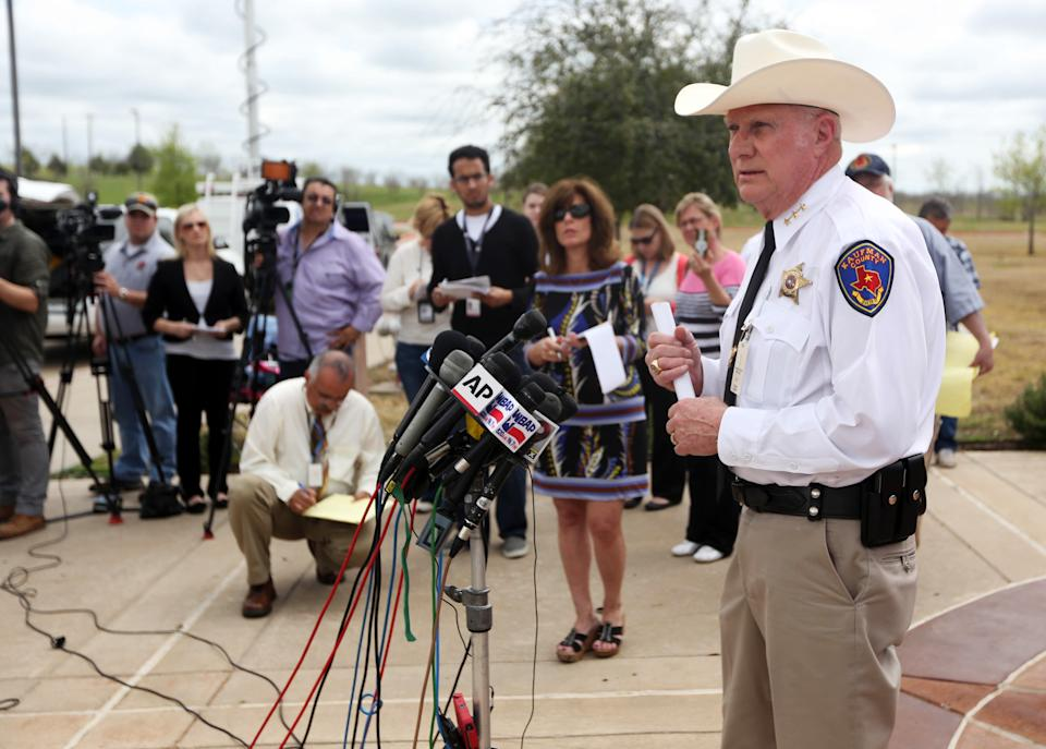 Kaufman County Sheriff David Byrnes, right, speaks at a news conference, Sunday, March 31, 2013, in Kaufman, Texas. On Saturday, Kaufman County District Attorney Mike McLelland and his wife, Cynthia, were murdered in their home. (AP Photo/Mike Fuentes)