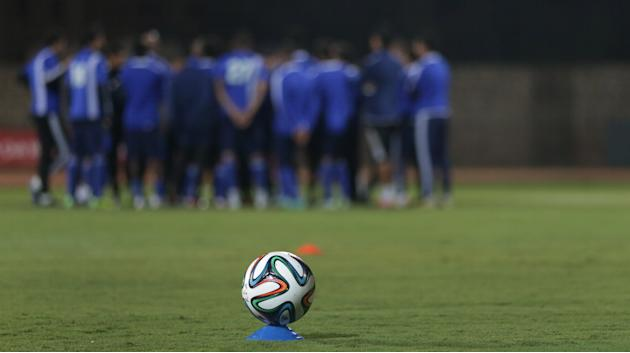 Team Raja Casablanca gather behind a tournament ball prior to last a training session in Agadir, Morocco, Friday, Dec. 13, 2013. Raja Casablanca will play CF Monterrey at the FIFA Club World Cup socce