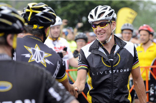 In this Aug. 22, 2010, file photo, cyclist Lance Armstrong greets fellow riders prior to the start of his Livestrong Challenge 10K ride for cancer in Blue Bell, Pa. Armstrong said Wednesday, Oct. 17,