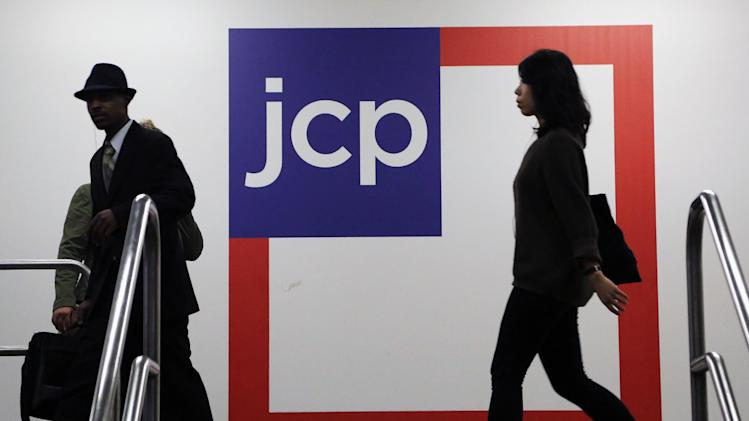 FILE - In this Tuesday, April 9, 2013, file photo, customers shop at a J.C. Penney store, in New York. J.C Penney reports quarterly earnings on Wednesday Nov. 20, 2013. (AP Photo/Mark Lennihan, File)