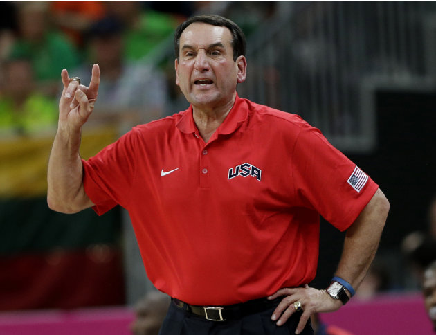 FILE- In this Aug. 4, 2012, file photo, United States coach Mike Krzyzewski signals to players during a preliminary men's basketball game against Lithuania at the 2012 Summer Olympics in London. A per
