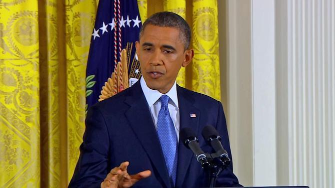 President Obama addresses fiscal cliff, Petraeus scandal at news conference