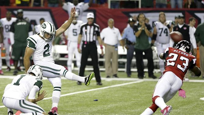 New York Jets kicker Nick Folk (2) kicks the winning field goal against Atlanta Falcons cornerback Robert Alford (23) during the second half of an NFL football game, Monday, Oct. 7, 2013, in Atlanta. The Jets won 30-28