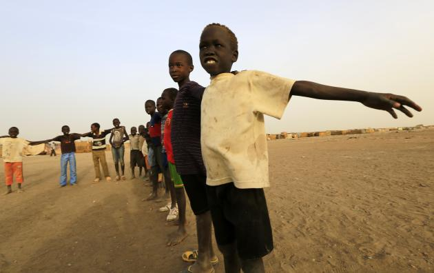 South Sudanese children living in the North gather to play soccer in an IDP camp at Soba Aradi in Khartoum