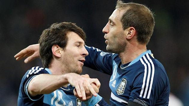 Argentina's Lionel Messi celebrates his first goal against Switzerland with teammate Pablo Zabaleta during their international friendly soccer match at the Stade de Suisse stadium in Bern