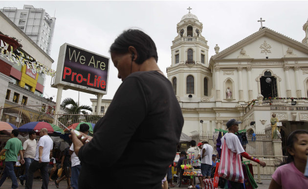 "A ""Pro-Life"" sign flashes on an electric signboard outside the Roman Catholic Minor Basilica of the Black Nazarene in downtown Manila, Philippines on Thursday, Jan. 3, 2013. Philippine President Benig"