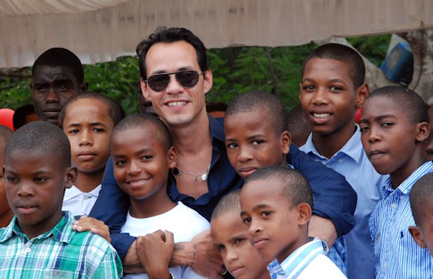 In this image released by the Maestro Cares Foundation, singer Marc Anthony poses for a photo with children from the Children of Christ orphanage in the eastern city of La Romana, Dominican Republic, Friday, Nov. 23, 2012. The foundation, run by Anthony with music and sports producer Henry Cardenas, plans to build a new residence hall, classrooms and a baseball field for the orphanage founded in 1996 for children who were abused or abandoned or whose parents were unable to care for them. (AP Photo/Maestro Cares Foundation)