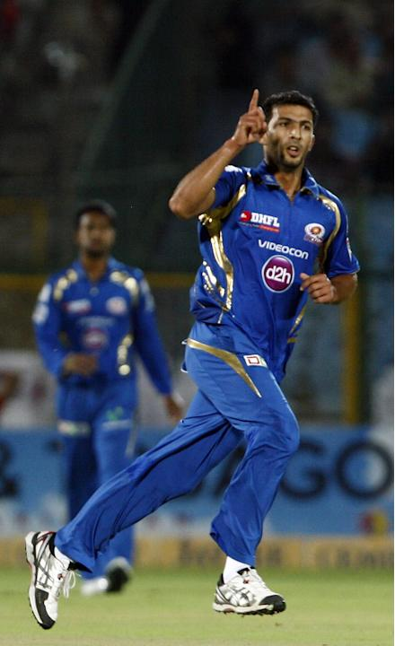 MI bowler Rishi Dhawan in action during the match between Lions and Mumbai Indians at Sawai Mansingh Stadium, Jaipur on Sept. 27, 2013.(Photo: IANS)
