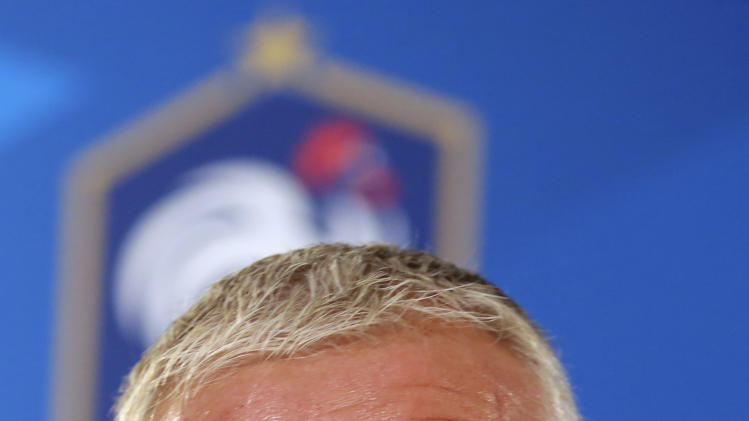 French national soccer team coach Didier Deschamps leaves at the end of a press conference in Paris, Thursday Aug. 28, 2014. France will face Spain Thursday Sept. 4, in a friendly match in Paris. (AP Photo/Remy de la Mauviniere)