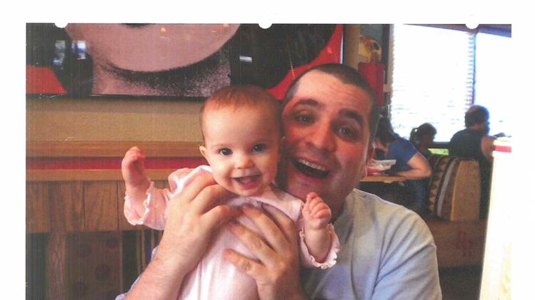 FILE - This undated file photo submitted into evidence by defense attorney Julia L. Gatto shows New York City police Officer Gilberto Valle with his daughter. Valle, accused of plotting to kidnap, cook and eat women _ including his wife _ was convicted of conspiracy Monday, March 12, 2013. (AP Photo/Provided by Attorney Julia L. Gatto, File)