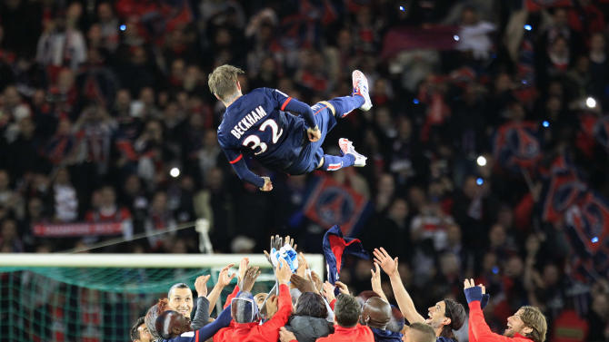 Paris Saint Germain's midfielder David Beckham from England, is thrown in the air by his teammate at the end of their French League One soccer match against Brest, at the Parc des Princes stadium, in Paris, Saturday, May 18, 2013. Paris Saint-Germain hopes to strike a deal with David Beckham in the next two weeks in which the former England captain will work with the French club after retirement, possibly in an ambassadorial role. (AP Photo/Thibault Camus)