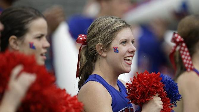 Rain soaked members of the Louisiana Tech cheerleaders perform in the first half of a NCAA college football game against Army, Saturday, Sept. 28, 2013, in Dallas