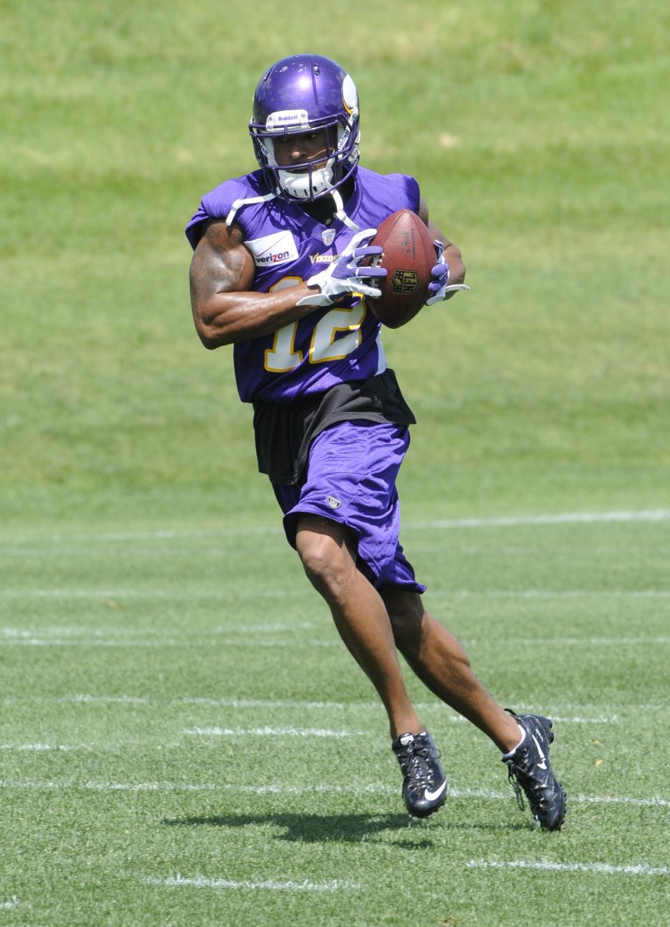 Minnesota Vikings wide receiver Percy Harvin carries the ball during NFL football practice, Thursday, June 21, 2012, in Eden Prairie, Minn. Harvin has asked to be traded, saying earlier in the week he was upset with the team but not elaborating. (AP Photo/Jim Mone)
