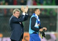 England's coach Roy Hodgson applauds the supporters at the end of the World Cup 2014 qualifying football match between Moldova and England in Chisinau. Hodgson faces a nervous wait to discover if John Terry will be fit for Tuesday's World Cup qualifier against Ukraine after the Chelsea defender played through the pain barrier in the 5-0 rout of Moldova