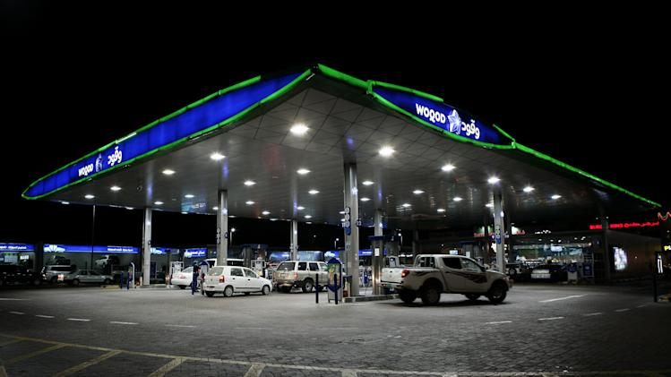 This Saturday, Dec. 1, 2012 photo, shows the general view of a gas station in Doha, Qatar. The host of the current U.N. climate talks, Qatar, is among dozens of nations that keep gas prices low through subsidies that exceeded $500 billion globally last year. (AP Photo/Osama Faisal)