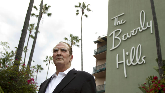 "In this April 25, 2012 photo, Robert S. Anderson, author and Beverly Hills Hotel historian, poses for a portrait in front of the Beverly Hills Hotel in Beverly Hills, Calif.  Anderson's book ""The Beverly Hills Hotel - The First 100 Years"" celebrates the 100th anniversary of the Beverly Hills Hotel. (AP Photo/Matt Sayles)"