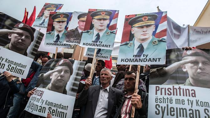 Kosovo Albanians hold portraits of former Kosovo Liberation Army commander Sylejman Selimi during a protest in Pristina on June 17, 2015