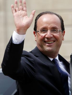 New President Francois Hollande waves as he leaves the Elysee Palace Tuesday, May 15, 2012 in Paris.  (AP Photo/Thibault Camus)