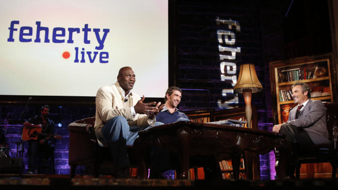 IMAGE DISTRIBUTED FOR GOLF CHANNEL - Charlotte Bobcats owner Michael Jordan, left, Olympic champion Michael Phelps, center, and David Feherty as seen at Golf Channel's 'Feherty Live From the Ryder Cup', on Monday, September 24, 2012 at the Tivoli Theatre in Downers Grove, IL. (Ross Dettman/AP Images for Golf Channel)