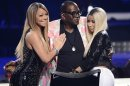 "File photo of Randy Jackson being embraced by Mariah Carey and Nicki Minaj as he finishes his final season as a judge during the Season 12 finale of ""American Idol"" in Los Angeles"