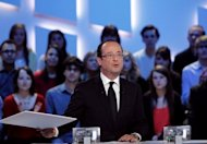 France&#39;s Socialist Party (PS) presidential candidate Francois Hollande takes part in the TV show &quot;Le grand journal&quot; on a set of French TV Canal+