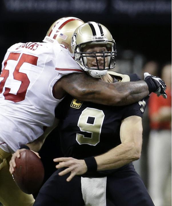 In this Nov. 17, 2013, file photo, New Orleans Saints quarterback Drew Brees (9) is sacked by San Francisco 49ers outside linebacker Ahmad Brooks (55) in the second half of an NFL football game in New