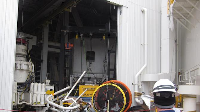 This Jan. 10, 2013, photo provided by the U.S. Coast Guard shows an inspector surveying damaged parts and equipment aboard the Shell Arctic drilling rig Kulluk in Kiluida Bay, near Kodiak, Alaska. The rig grounded on Sitkalidak Island on Dec. 31, 2012, and was towed to Kiliuda Bay Jan. 7, 2013. The unified command overseeing salvage of the rig says it will release minimal information on the vessel until an assessment is complete. (AP Photo/U.S. Fish and Wildlife Service)