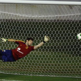 Spain's goalkeeper Iker Casillas tries to save a ball during a training session ahead of the Confederations Cup tournament in Rio de Janeiro