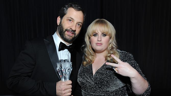 IMAGE DISTRIBUTED FOR LOUIS XIII - Judd Apatow toasts his Critics' Choice LOUIS XIII Genius Award with Rebel Wilson at the Critcs' Choice Movie Awards at Barker Hangar on Thursday, Jan. 10, 2013 in Santa Monica, Calif. (Photo by Jordan Strauss/Invision for LOUIS XIII/AP Images)
