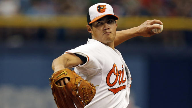 Baltimore Orioles starting pitcher Wei-Yin Chen throw during the first inning of a baseball game against the Tampa Bay Rays, Sunday, May 3, 2015, in St. Petersburg, Fla. The game was moved from Baltimore to St. Petersburg due to civil unrest. (AP Photo/Mike Carlson)