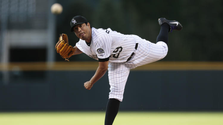 De La Rosa pitches Rockies past Marlins, 2-1