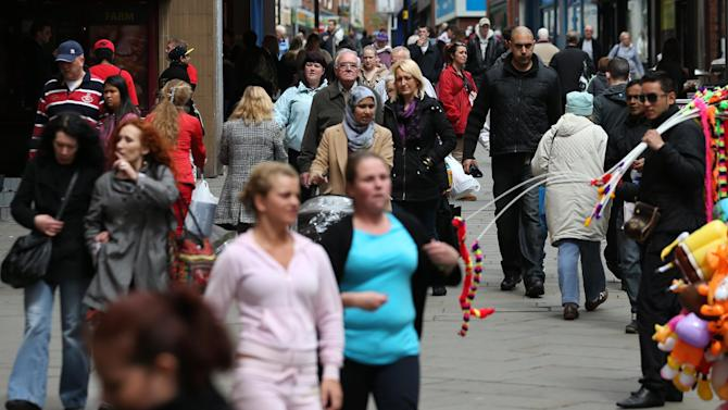 In this Wednesday May 16, 2012 photo, pedestrians walk through Yorkshire Street in Rochdale, England. Nearly 1 million Pakistanis live in England - far more than in any other European country - with about 25,000 settled in the greater Manchester area that includes Rochdale. (AP Photo/Jon Super)