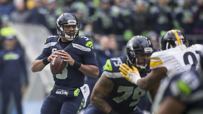 Quarterback Russell Wilson of the Seattle Seahawks looks to pass during the first half of their game against the Pittsburgh Steelers, at CenturyLink Field in Seattle, Washington, on November 29, 2015