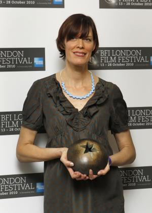 Clio Barnard collects the Best British Newcomer Award during the London Film Festival 2010 Awards ceremony, held at the LSO in central London, Wednesday, Oct. 27, 2010. The festival runs for a fortnight until 28 October. (AP Photo/Joel Ryan)