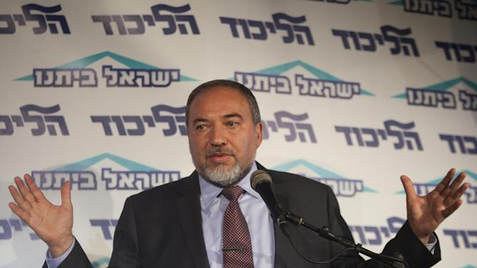 FILE - in this Thursday, Dec. 13, 2012 file photo, Israeli Foreign Minister Avigdor Lieberman speaks to the media during an event of his political party in  Tel Aviv, Israel, on Friday, Dec. 14, 2012 Lieberman has announced he is resigning a day after an indictment for breach of trust was filed against him by the country's attorney general. (AP Photo/Dan Balilty, File)