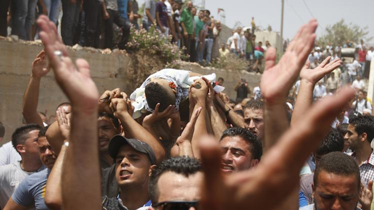 Palestinians carry the body of Ali Khalifa, 25, killed by the Israeli military, during his funeral in the Qalandiya refugee camp near the West Bank city of Ramallah, Monday, Aug. 1, 2011. A Palestinian health official says Israeli troops have killed Khalifa and another Palestinian man in clashes at the Qalandiya refugee camp. A Palestinian security official says the men were involved in rock-throwing and scuffles with Israeli soldiers who had come to the West Bank refugee camp around dawn Monday on an arrest raid. (AP Photo/Majdi Mohammed)