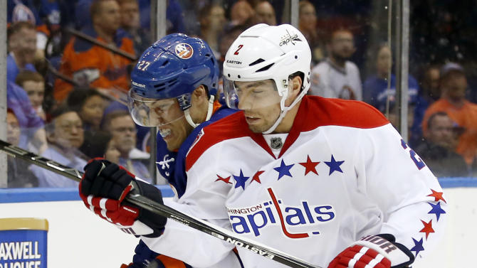 FILE - In this April 21, 2015, file photo, Washington Capitals defenseman Matt Niskanen (2) checks New York Islanders center Anders Lee (27) during Game 4 of a first-round NHL Stanley Cup hockey playoff series in Uniondale, N.Y. Count Niskanen among those around the NHL who took a wait-and-see approach when it came to the league's new 3-on-3 overtime format. (AP Photo/Kathy Willens, File)