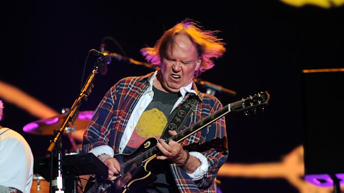 Musician Neil Young performs with his band Crazy Horse at the Global Citizen Festival in Central Park on Saturday Sept. 29, 2012 in New York. (Photo by Evan Agostini/Invision/AP)