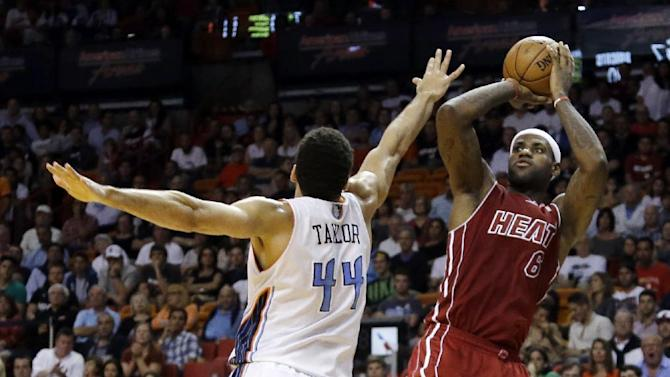 Bosh's heroics lift Miami past Charlotte, 99-98