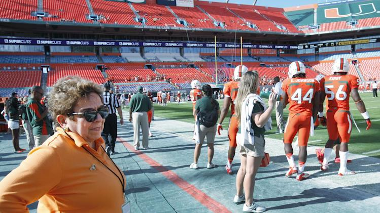 In this Nov. 17, 2012, file photo, Miami president Donna Shalala watches players during warmups before the start of an NCCA college football game between the Miami and the South Florida in Miami. Shalala would prefer Hurricane athletes get their degrees before leaving school, taking advantage of the scholarships they've been afforded
