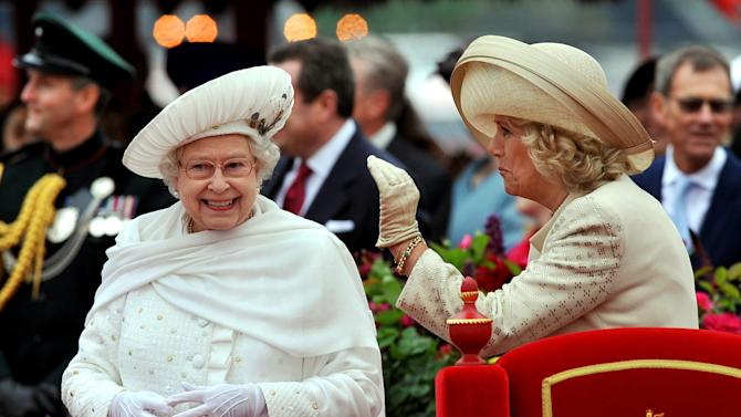 Britain's Queen Elizabeth II, left, and Camilla, Duchess of Cornwall, speak while on the royal barge during the Diamond Jubilee Pageant on the River Thames in London, Sunday, June 3, 2012.  More than 1,000 boats will sail down the River Thames on Sunday in a flotilla tribute to Queen Elizabeth II's 60 years on the throne. (AP Photo/John Stillwell, Pool)