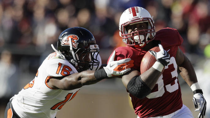 Stanford running back Stepfan Taylor (33) runs past Oregon State cornerback Rashaad Reynolds (16) to score on a 40-yard touchdown reception during the third quarter of an NCAA college football game in Stanford, Calif., Saturday, Nov. 10, 2012. (AP Photo/Jeff Chiu)