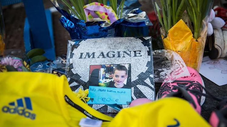 A photo of Martin Richard, a victim of the Boston bombing, is displayed near the finish line of the Boston Marathon on April 20, 2014