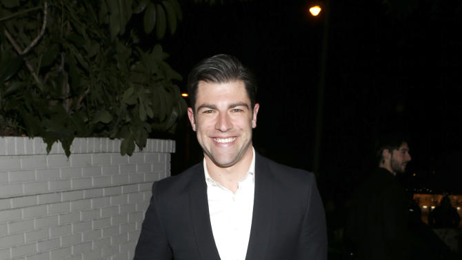 Max Greenfield arrives in a Cadillac XTS to the W Magazine's Best Performances and Golden Globe Awards Party Presented by Cadillac, on Friday, January, 11, 2013 in Los Angeles. (Photo by Todd Williamson/Invision for Cadillac/AP Images)