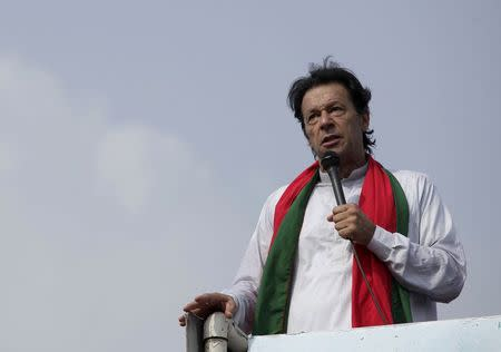 """Chairman of the Pakistan Tehreek-e-Insaf (PTI) political party Imran Khan addresses his supporters during what has been dubbed a """"freedom march"""" in Islamabad"""
