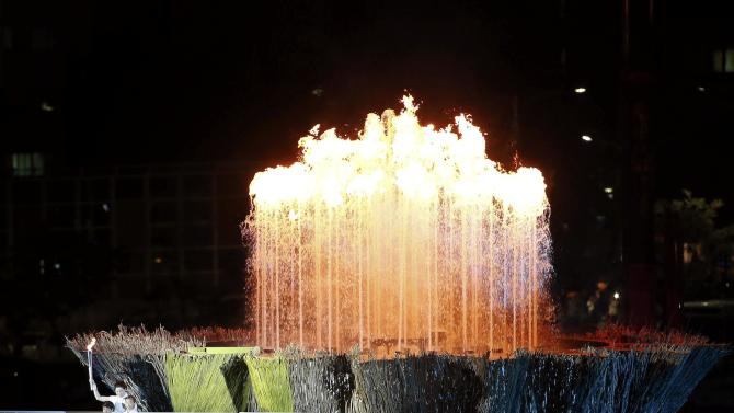 The flame for the 17th Asian Games is lit during the opening ceremony at the Incheon Asiad Main Stadium