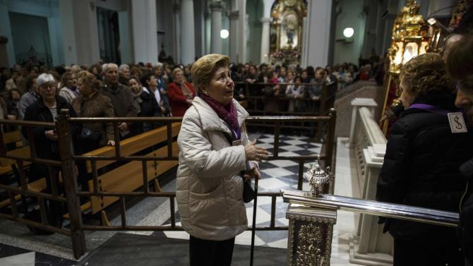 People pray during a mass at the Basilica of Jesus de Medinaceli in central Madrid