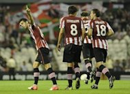 Athletic Bilbao&#39;s Markel Susaeta (L) celebrates after scoring during their Europa League match against Hapoel Kiryat Shmona FC on September 20. Athletic face Real Sociedad on Saturday