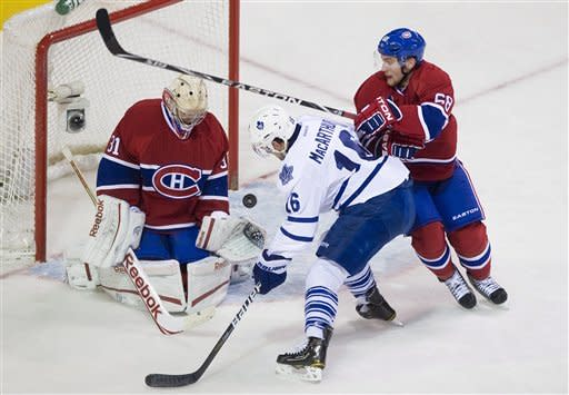 Grabovski leads Maple Leafs in Carlyle's debut